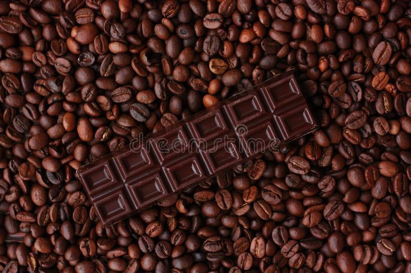Delicious brown chocolate and coffee beans close up stock photos