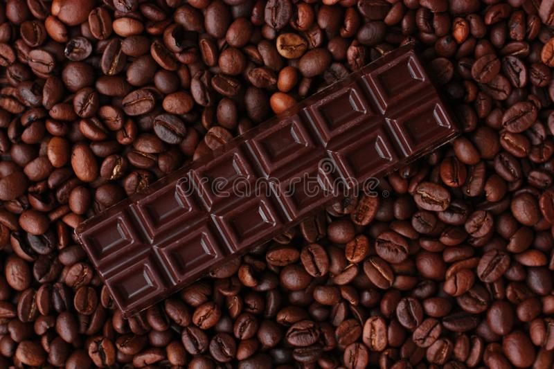 Delicious brown chocolate and coffee beans close up royalty free stock image