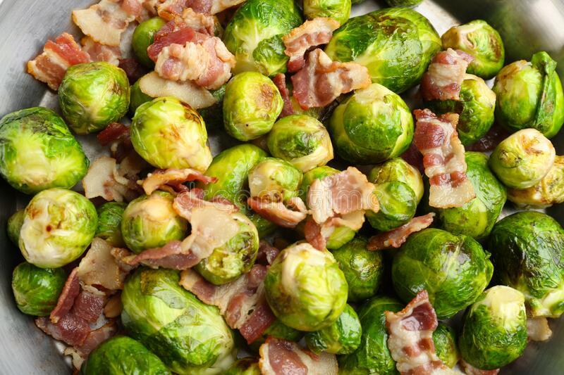 Delicious Brussels sprouts with bacon. Top view stock photos
