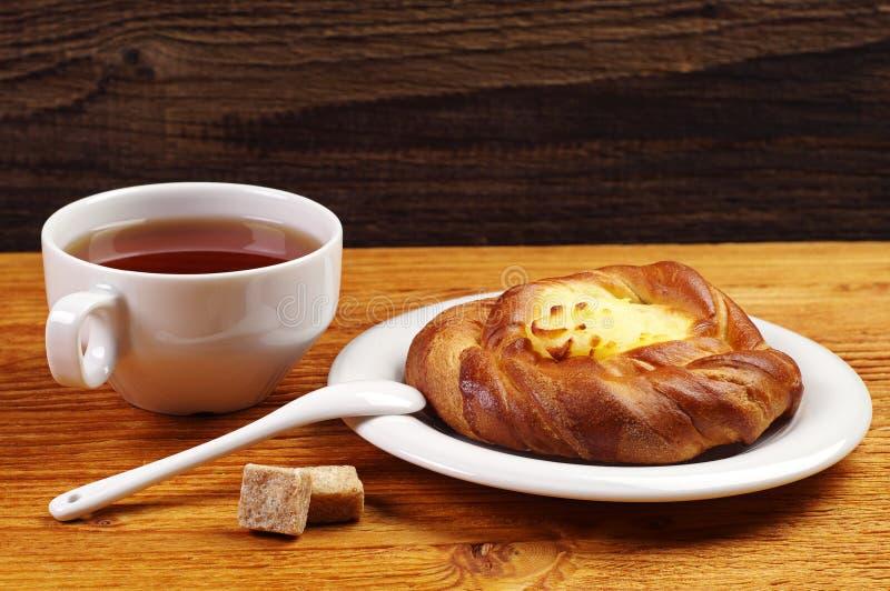 Delicious Bun And Tea Stock Photo