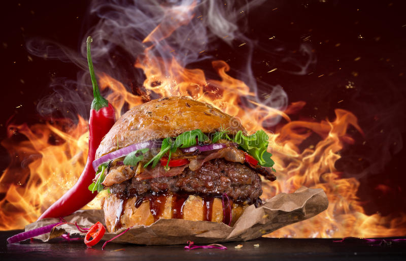 Delicious burger with bbq sauce royalty free stock photo