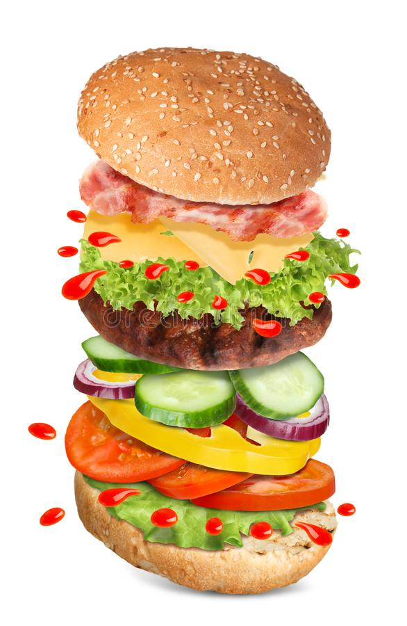 Delicious burger with different flying ingredients stock photo