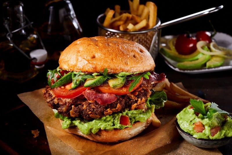 Delicious burger with fresh avocado and guacamole stock photo