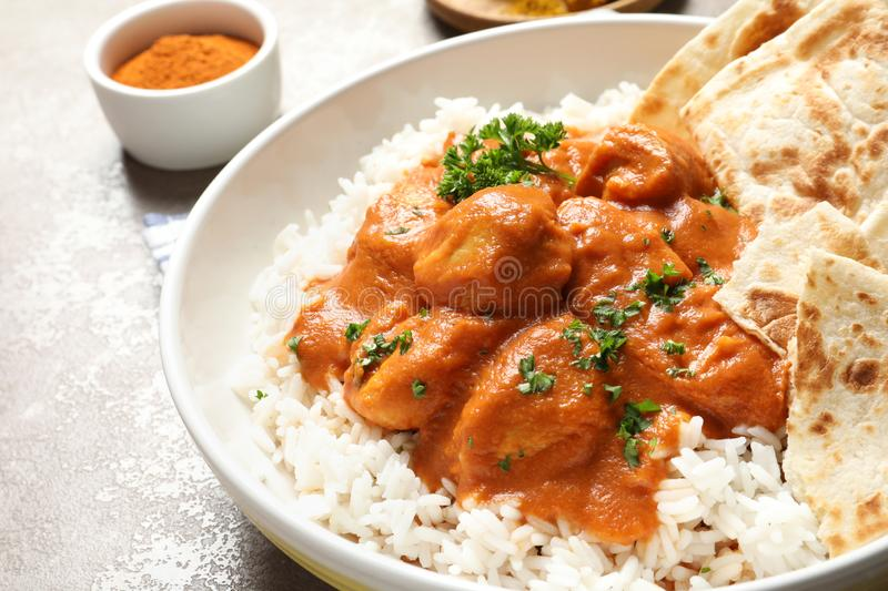 Delicious butter chicken with rice in plate on table. Closeup royalty free stock images