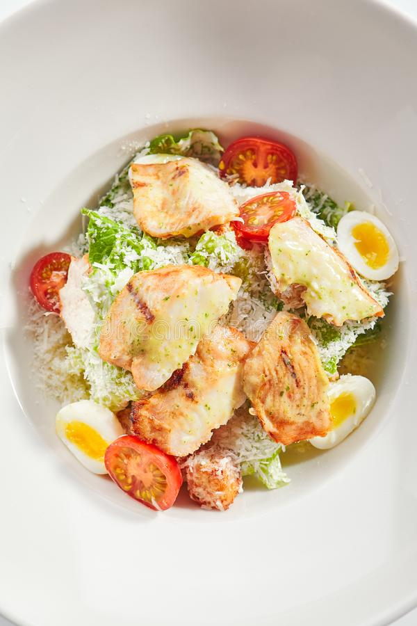 Delicious caesar with chicken fillet top view stock image