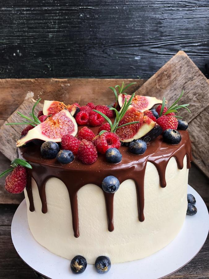 Delicious cake with berries and figs on the table royalty free stock photo