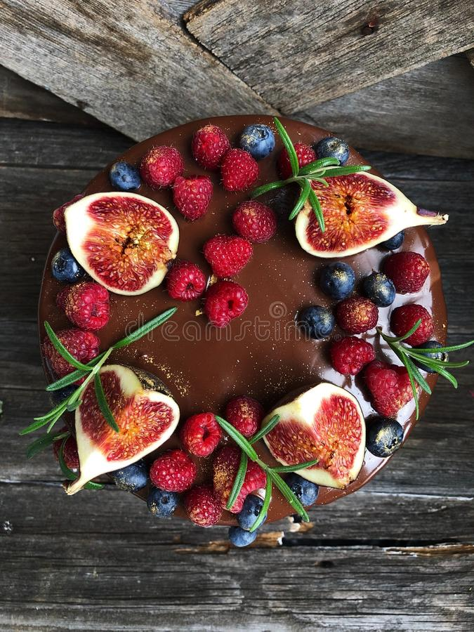 Delicious cake with berries and figs on the table stock images
