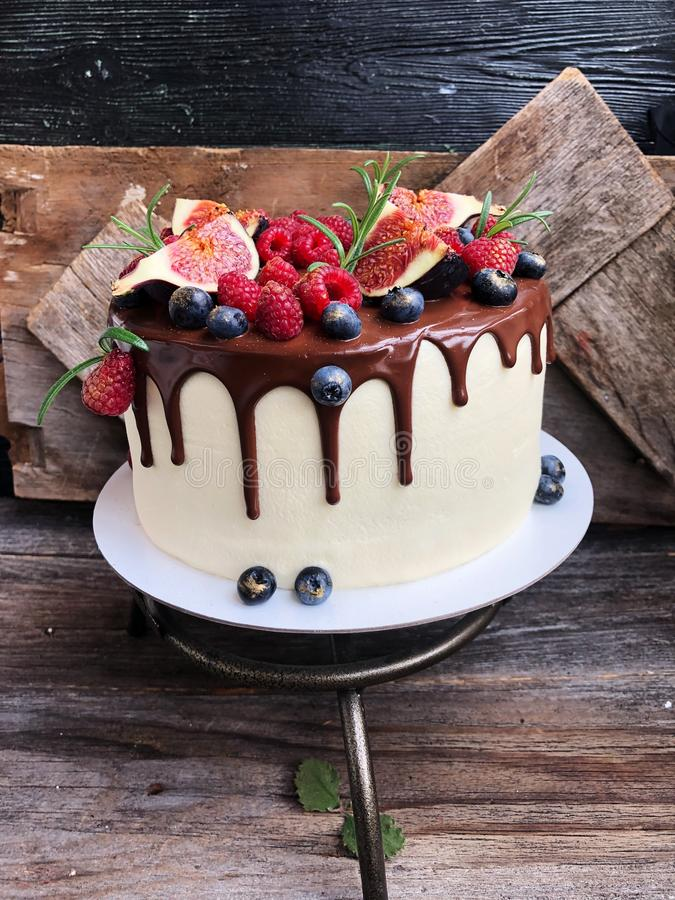 Delicious cake with berries and figs on the table royalty free stock image