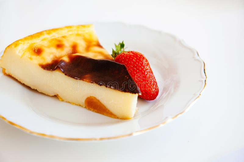 Delicious cake with cheese and strawberry stock images