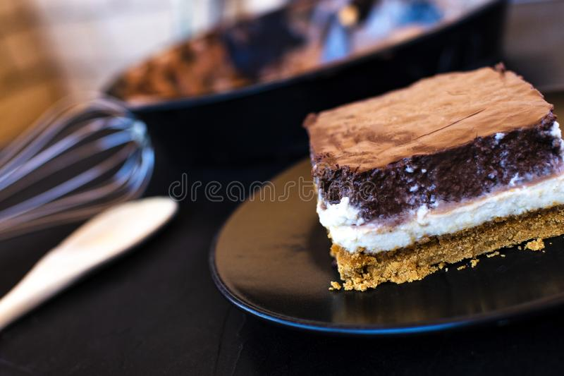 Delicious cake composed of three chocolates royalty free stock photography