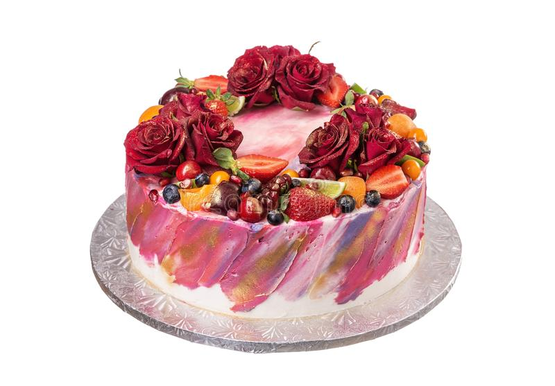 Delicious cake decorated with flowers and fruits. On birthday. stock photos
