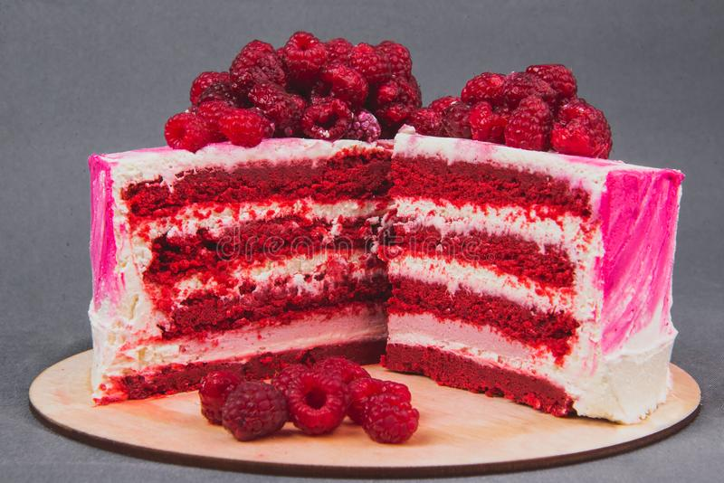 A delicious cake decorated with raspberries on a gray background. royalty free stock photos