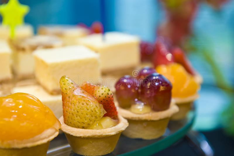 Delicious canapes and sweets. A plate of delicious canapes and sweets on the serving table at a launch reception royalty free stock photography