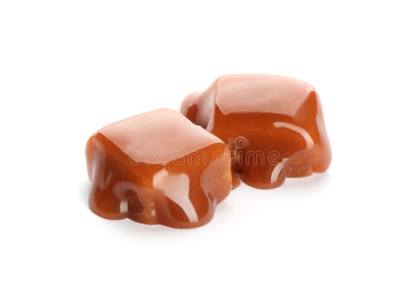 Delicious candies with caramel sauce. On white background stock photo