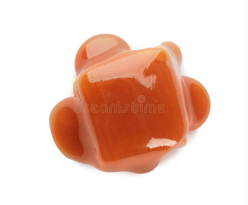 Delicious candy with caramel sauce on white background. Top view stock photo