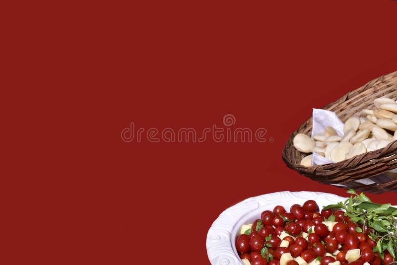 Delicious caprese salad with ripe cherry tomatoes and mini mozzarella cheese balls with fresh basil leaves. Italian healthy food royalty free stock photo