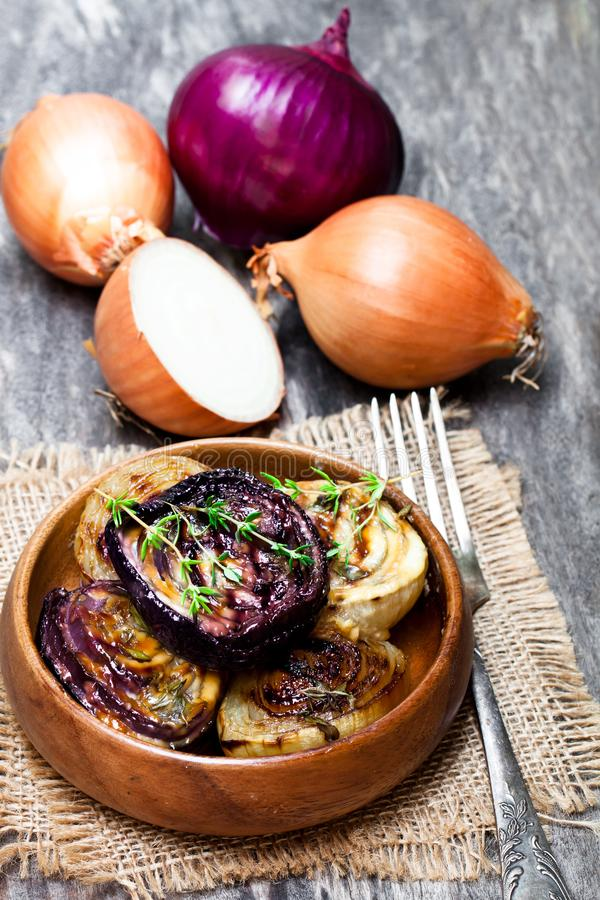 Delicious caramelized onions in balsamic vinegar with thyme stock photos