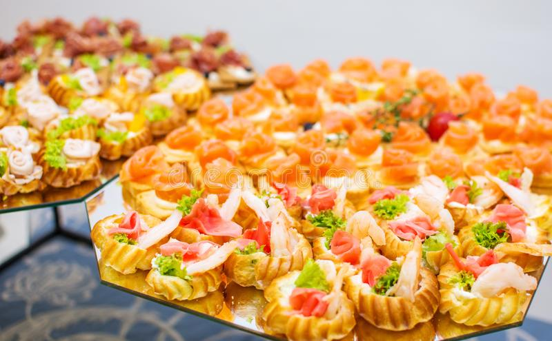 Delicious catering canapes on a buffet table royalty free stock photos