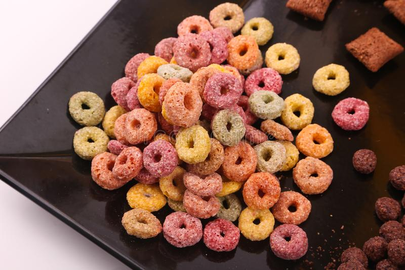 Delicious cereal. Delicious coloured and brown cereal on white background stock images