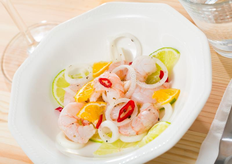 Delicious ceviche with shrimp, lime, onion royalty free stock photo