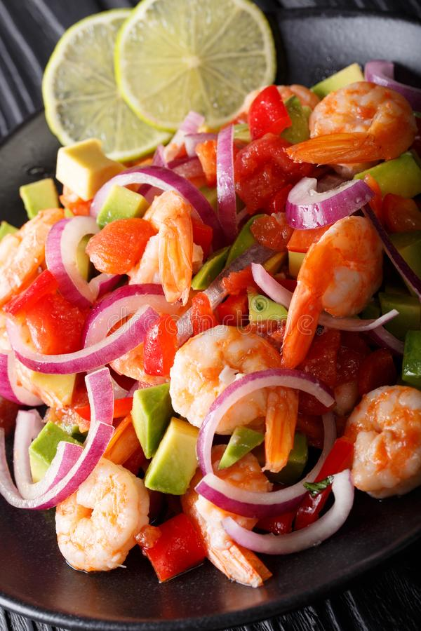 Delicious ceviche of shrimp with vegetables, spices and lime close up on a plate. vertical stock images