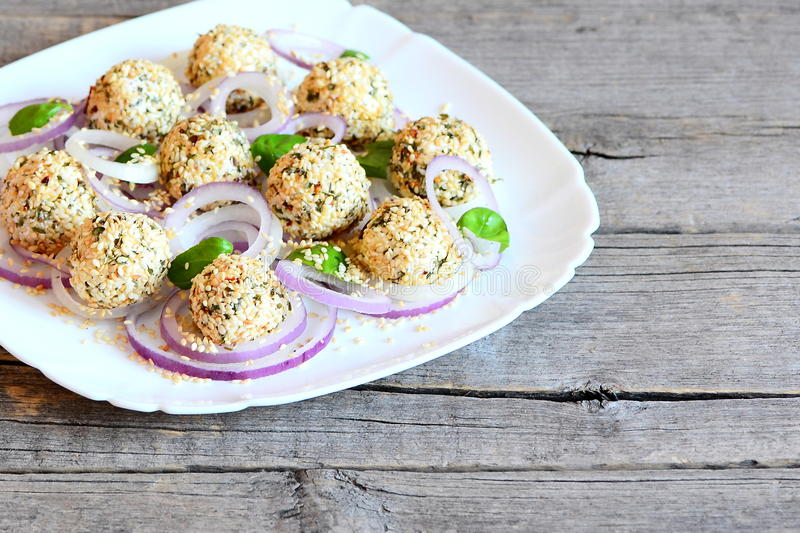 Download Delicious Cheese Balls With Dried Herbs And Roasted Sesame Seeds Served With Onion Rings And & Delicious Cheese Balls With Dried Herbs And Roasted Sesame Seeds ...