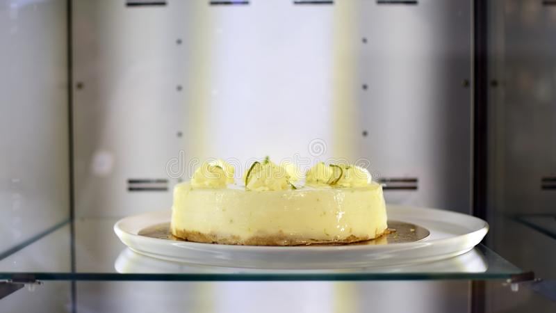Delicious cheese-cake with whipped cream at bakery display stock photos