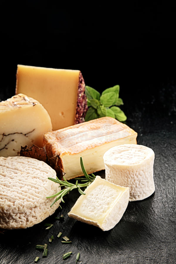 Delicious cheese platter with herbs stock image
