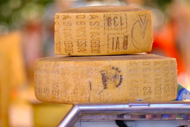 Delicious cheese, street market. High quality bright and clear photo of traditional italian cheese - Parmesan or Parmigiano Reggiano. You may see quite closely stock photos