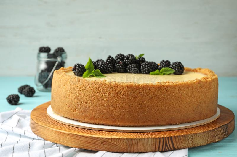 Delicious cheesecake with blackberries on table. Delicious cheesecake decorated with blackberries on table royalty free stock images