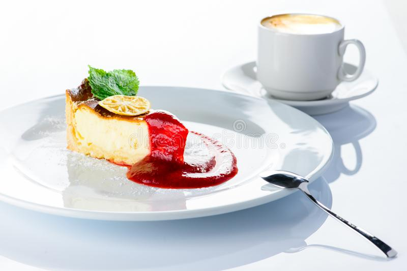 Delicious cheesecake with jam, citrus, mint and powdered sugar o stock images