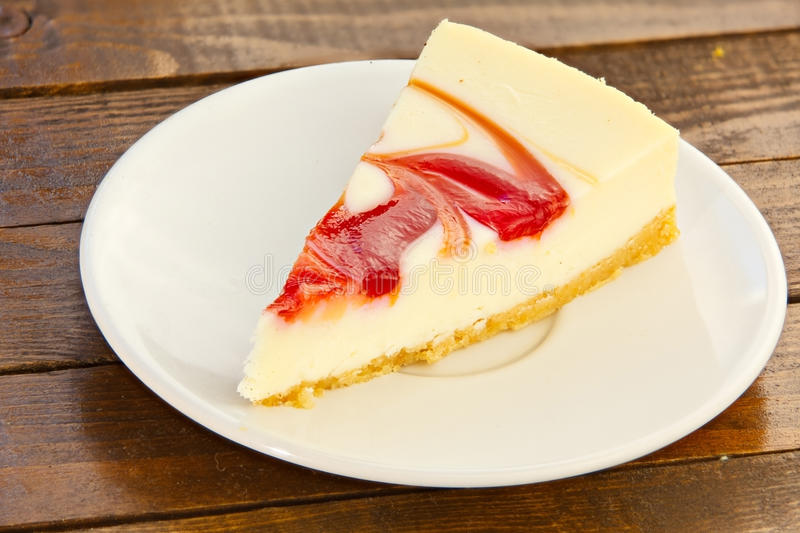Delicious cheesecake with strawberries stock photography