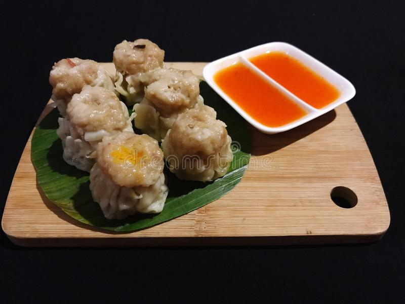 Delicious Chicken Dim Sum with Sweet-spicy sauce. royalty free stock image