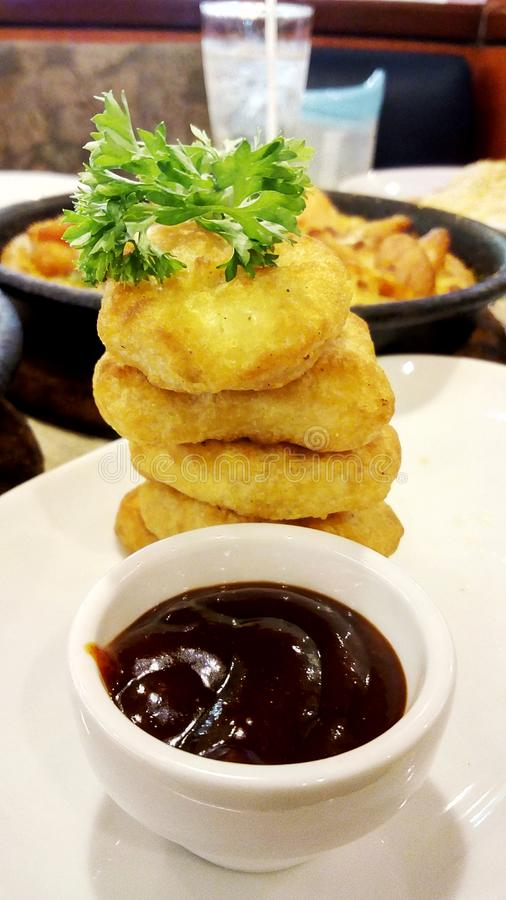 Delicious Chicken nuggets and barbeque sauce stock photo