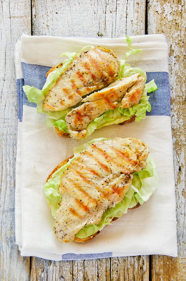 Delicious chicken sandwiches with bread butter cab royalty free stock photography