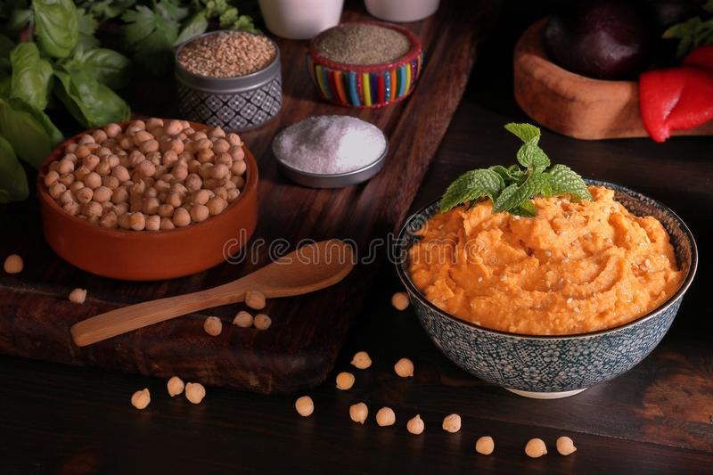 DELICIOUS CHICKPEAS HUMMUS MADE WITH PEPPERS stock photo