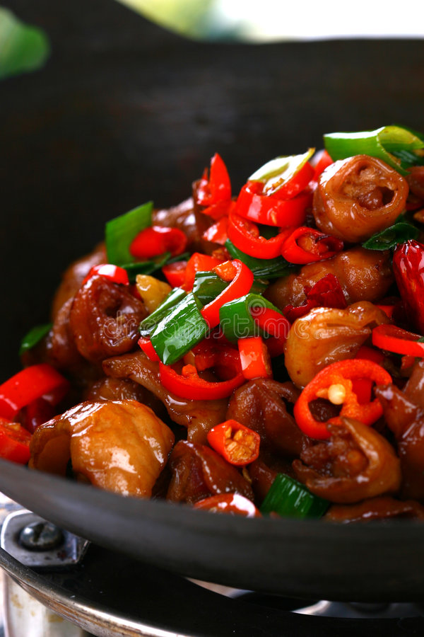 Delicious Chinese food fried dish - hot pepper sau. Sage with beautiful background in studio stock image