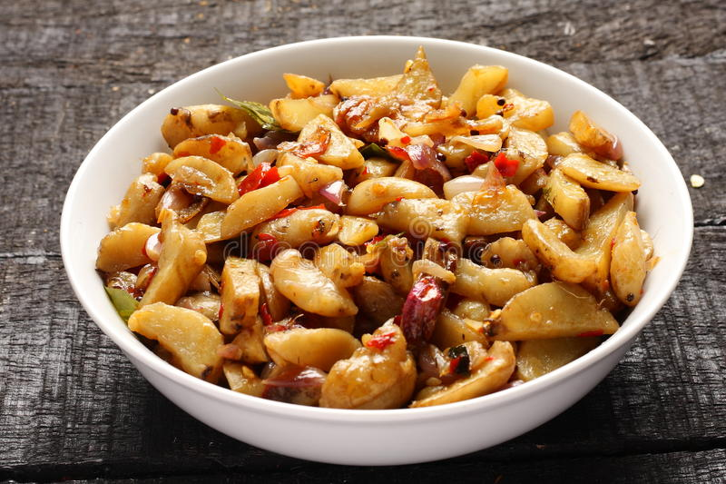 Delicious Chinese potato stir fry. In cast iron cookware stock photos