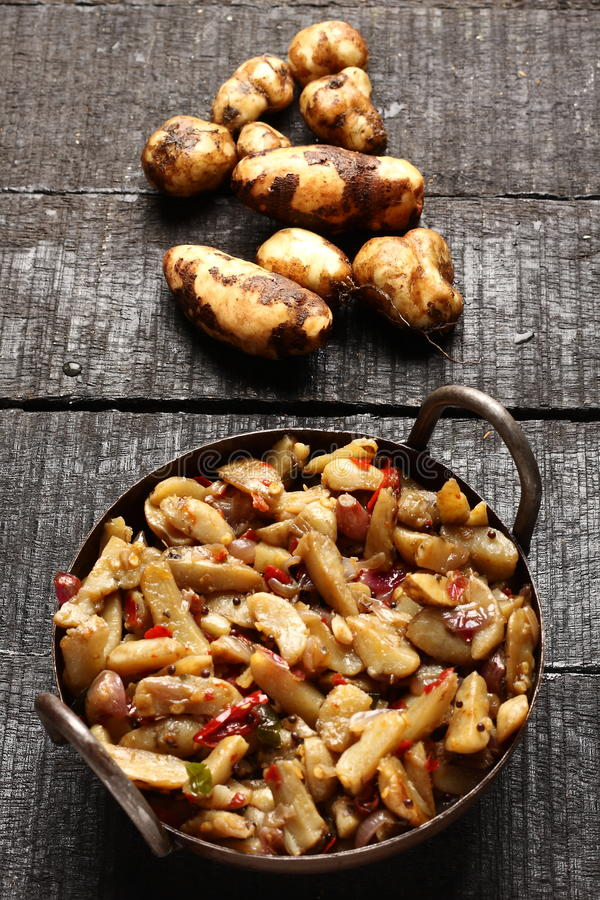 Delicious Chinese potato stir fry. In cast iron cookware stock images