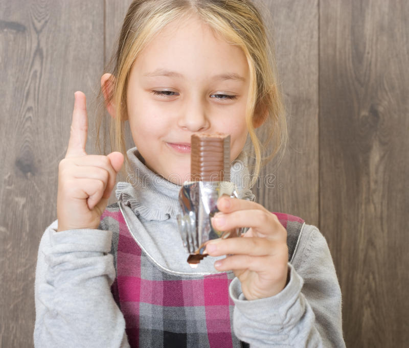 Delicious chocolate bar. Child is going to eat a delicious chocolate bar royalty free stock photography