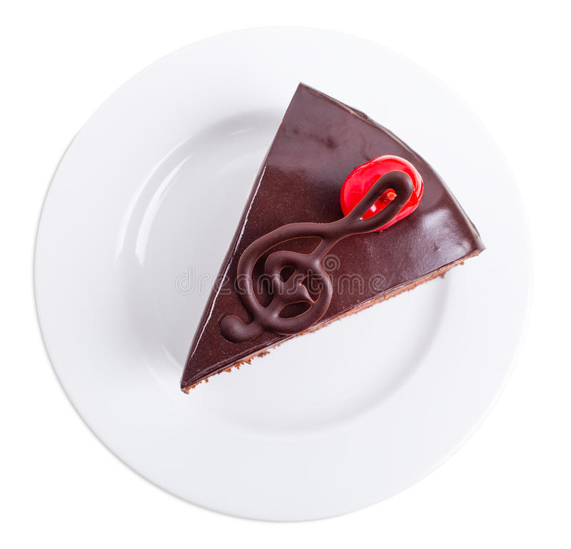 Delicious chocolate cake with cocktail cherry. royalty free stock photo