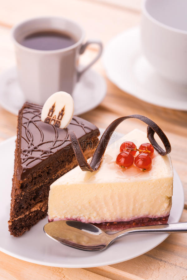 Delicious chocolate cake and cup of coffee stock photo