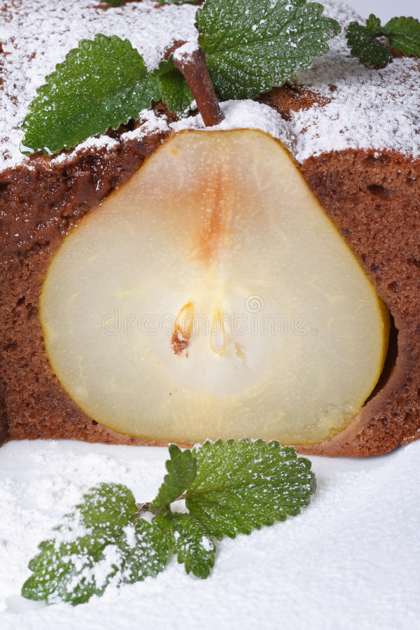 Delicious chocolate cake with pear halves macro vertical royalty free stock photo