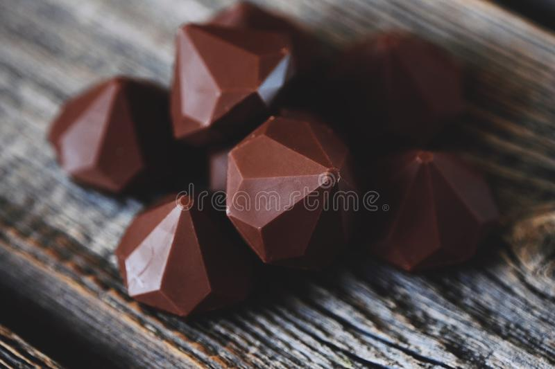 Delicious chocolate candies on gray wooden table royalty free stock photo