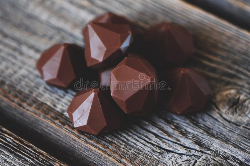 Delicious chocolate candies on gray wooden table royalty free stock images