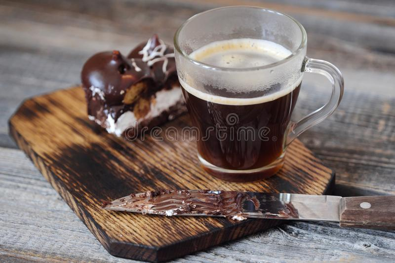 Delicious chocolate dessert with profiteroles and coffee royalty free stock photography