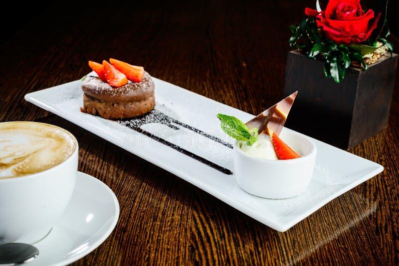 Delicious chocolate flan dessert and vanilla ice cream stock photography