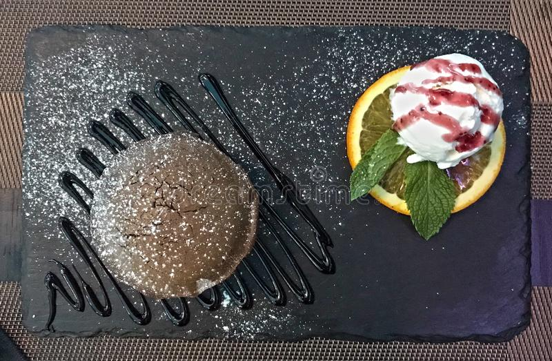 Delicious chocolate lava cake and ice cream royalty free stock photos