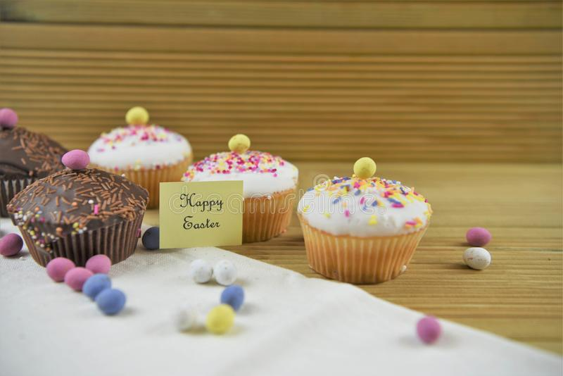 Delicious chocolate mini cakes with egg decorations and happy Easter words or text stock photos
