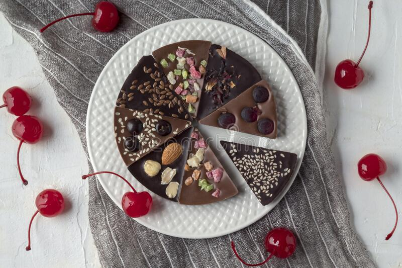 Delicious chocolate pizza and cherries on white table, flat lay composition stock image